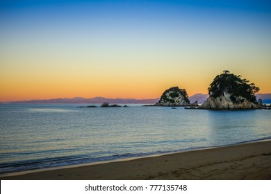 Creek and beach at sunset in Abel Tasman National Park. New Zealand