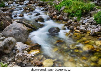 creek with running water in mountain