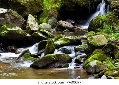 creek with water and stones in the mountains.
