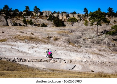 CREEL, MEXICO - Jan 2016: A native Raramuri couple walks through the barren landscape of the Valley of the Monks in Creel, near the Copper Canyon in northern Mexico