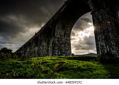 The Creeping Light: by a cloudy and rainy afternoon in a short instant the Sun succeeded to unfold its Light on the land under the Viaduct, Newry, County Down, Northern Ireland, United Kingdom