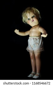 creepy antique doll stand in the dark and high contrast concept