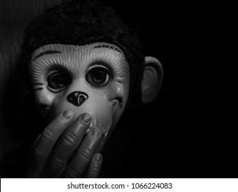 creepy ape's doll in black and white high contrast concept