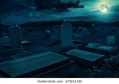 Creepy atmosphere in the cemetery with tombstone