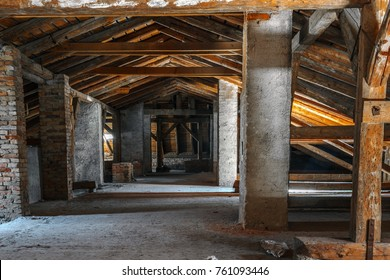 Creepy attic interior at abandoned industrial building