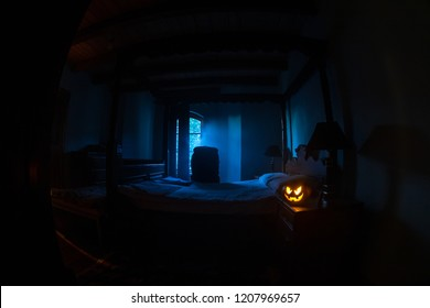 A creepy bedroom scenery, Antique scary bedroom with window and Halloween pumpkin. Horror Holiday concept