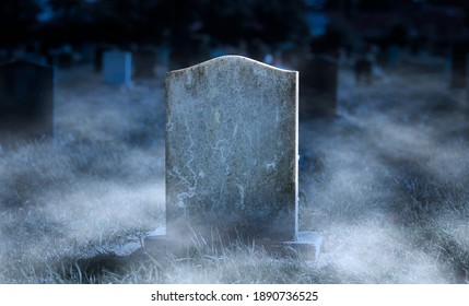 Creepy blank gravestone in graveyard at night with low spooky fog