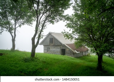 Creepy cabin at the edge of the fog in the Romanian countryside