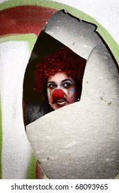 The Creepy Clown From Childhood Terrors Looks Through A Hole In The Wall With A Chilling Stare ?. Waiting And Watching
