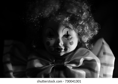 creepy clown doll in black and white high contrast concept