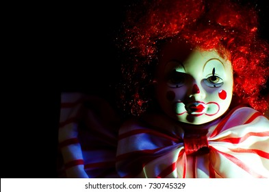 creepy clown doll looking in high contrast concept
