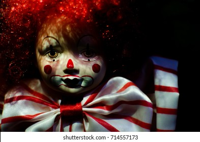 creepy clown doll smile in high contrast concept