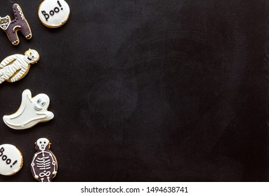 Creepy cookies for halloween treat frame on black background top view mockup