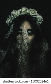 Creepy corpse zombie bride with white empty eyes on black background. Spooky halloween character and concept of horror movies