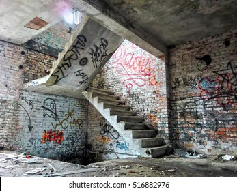 Creepy crumbling staircase inside abandoned building