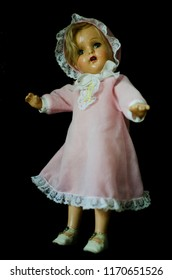 creepy cute doll in pink dress
