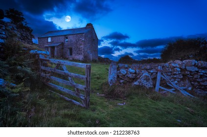 Creepy derelict haunted house under a full moon  (Elements of this image furnished by NASA)