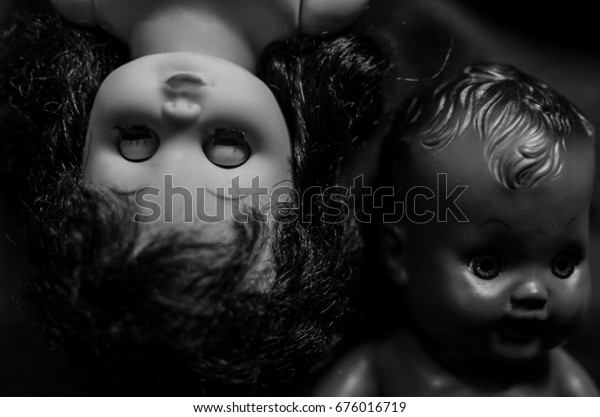 creepy doll black and white skin in high contrast
