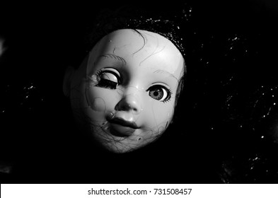 creepy doll drowning in the water and smile horror in black and white and high contrast