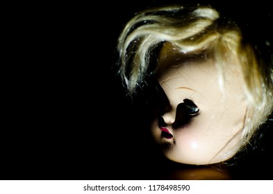 creepy doll half face in high contrast concept