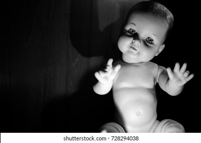 creepy doll hand up in black and white and high contrast concept