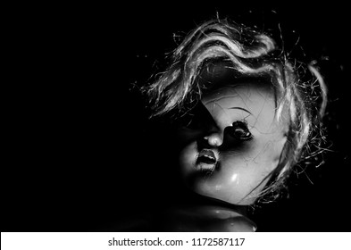 creepy doll head in black and white and high contrast concept