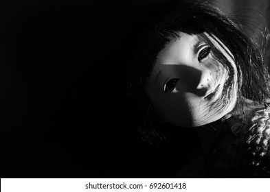 creepy doll in high contrast black and white