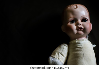 creepy doll lay down in the dark and high contrast concept