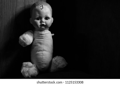 creepy doll look forward in the dark and high contrast concept