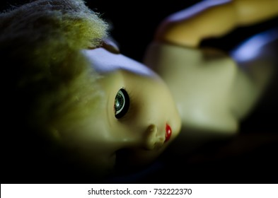 creepy doll look like dead and high contrast concept