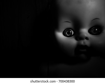 Creepy doll look like panicked in high contrast concept