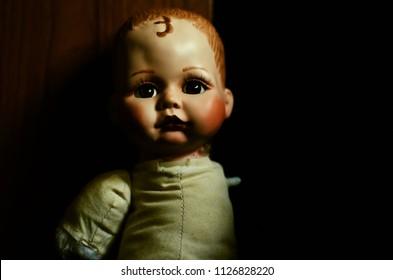 creepy doll look sad in high contrast concept