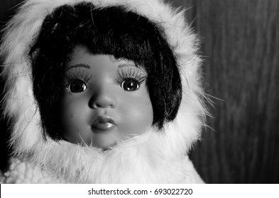 creepy doll look sad and tear in her eyes