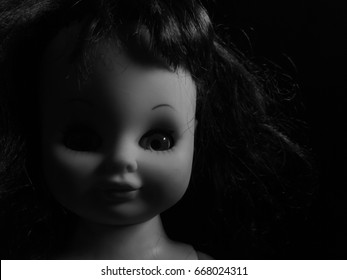 creepy doll look straight