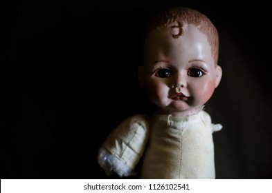 creepy doll looking forward in high contrast concept