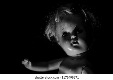 creepy doll smile's face in black and white and high contrast concept