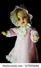 creepy doll stand in the dark