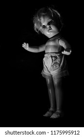 creepy doll stand in the dark in black and white and high contrast concept