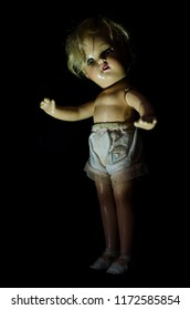 creepy doll stand in the dark in high contrast concept