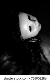 creepy doll's head in black and white