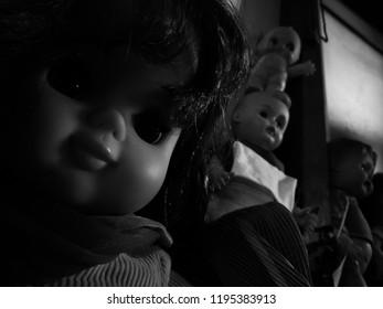 creepy dolls looking in the dark
