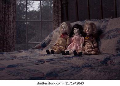 Creepy dolls on a bed