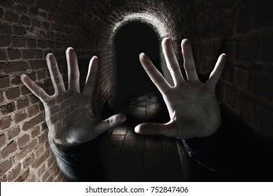 Creepy ghost hands in the dark scary underground, double exposure