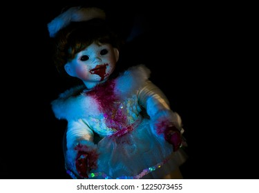 Creepy Halloween doll, freshly fed. Tonal image with an eerie expression.