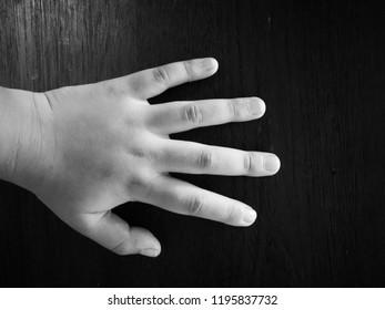 creepy hand in the dark blackground