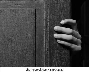 creepy hand open the door