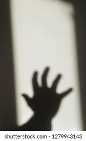 creepy hand in the shadows