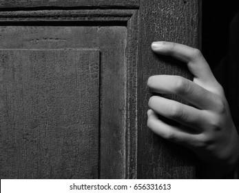creepy hand and vintage door
