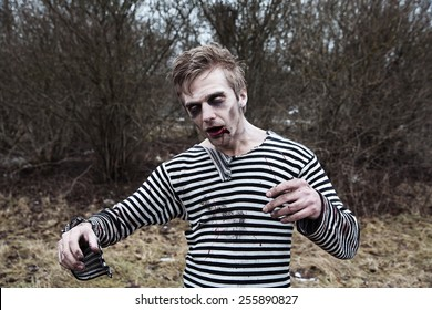 Creepy man with blood and zombie makeup