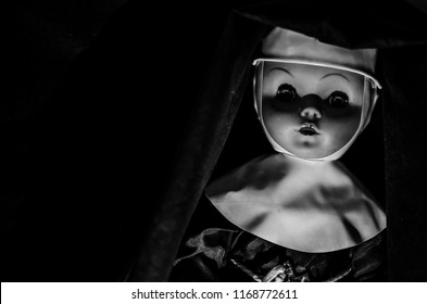 creepy nun doll looking in the dark in high contrast concept